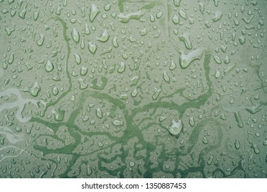 drops on the camping tents on a rainy day.