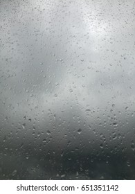 Drops on the glass of the cloud outside the window