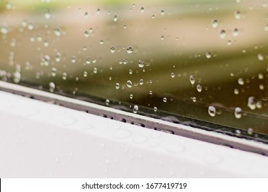 Drops on the glass of a plastic window after rain