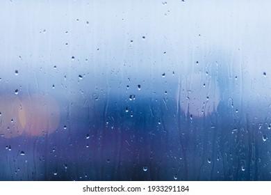 Drops on glass, rain behind a window