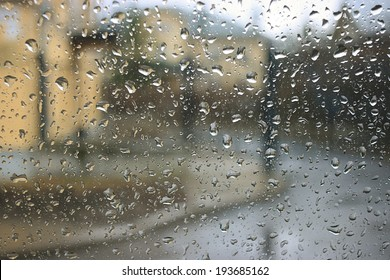 drops on the glass window texture street rain