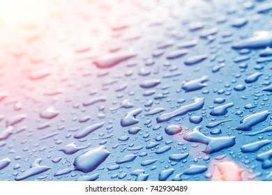 Drops on wet glass in the sunlight, background