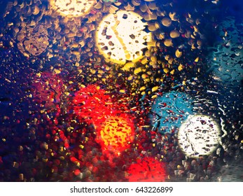 Drops Of Rain On Blue Glass Background with defocused lights. Street Bokeh Lights Out Of Focus. Autumn Abstract Backdrop
