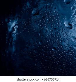 Drops of rain on glass , raindrops on clear window