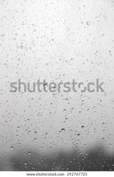 drops-rain-on-inclined-window-600w-29276