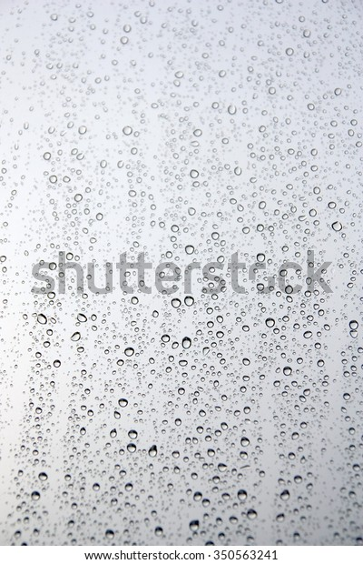 drops-rain-on-window-glass-600w-35056324