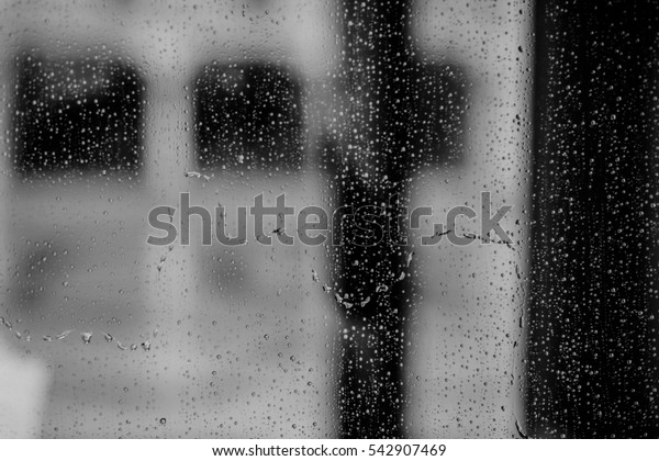 Drops of rain on a window glass.Through the window view of the sea