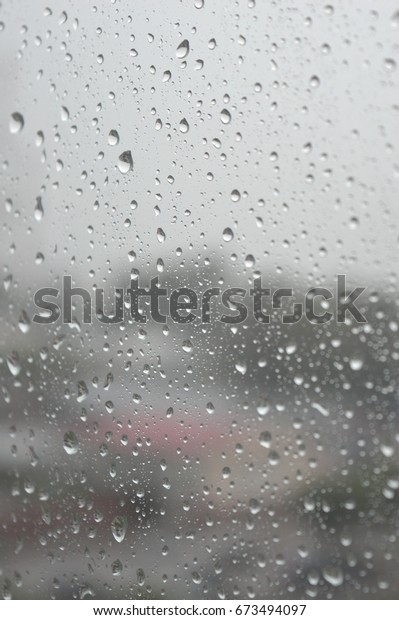 drops-rain-on-window-rainy-600w-67349409