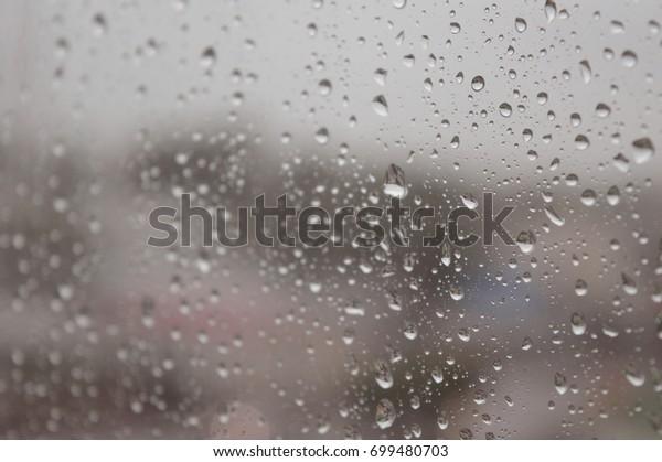 drops-rain-on-window-rainy-600w-69948070