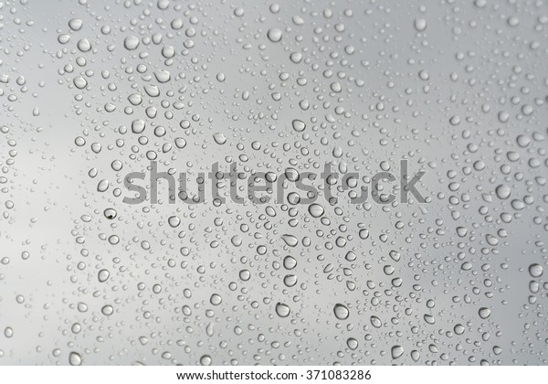 drops-rain-on-window-shallow-600w-371083
