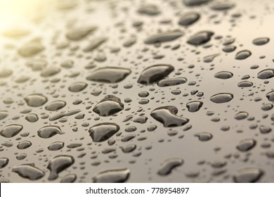 Drops of Rain or Water Drop on the Hood of the Car. Rain Drops on the Surface of the Car or on the Iron Surface Flow Down. Abstract Background and Water Texture for Design.