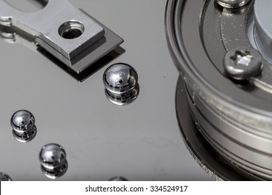 Drops representing data over a hard disk surface