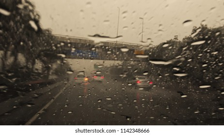 drops of water accumulated in the parabrisa, in a sudden summer rain on the marginal avenue of Tiete river, SP, Brazil