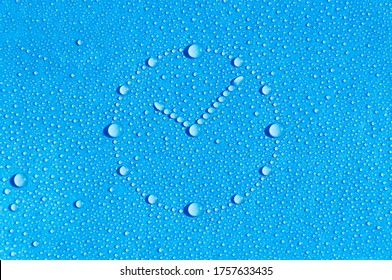 Drops of water in the form of a dial are located on a wet blue background. Abstract blue background. Time is water.