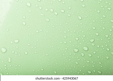 Drops of water on a color background. Green. Shallow depth of field. Selective focus. Toned.