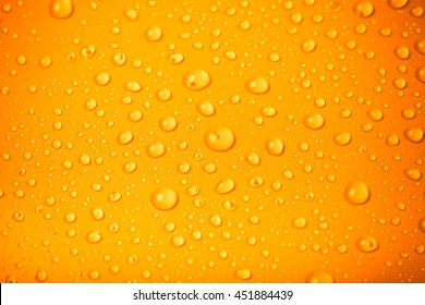 Drops of water on a color background. Orange. Shallow depth of field. Selective focus. Toned.
