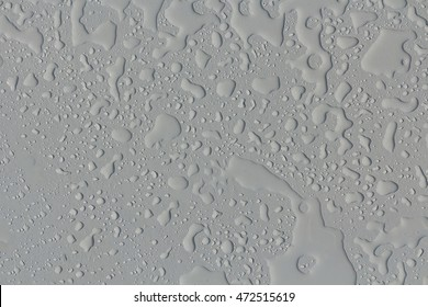 Drops of water on the concrete surface background.