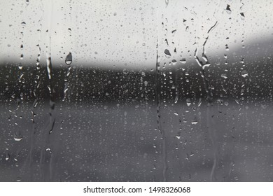 Drops of water on the glass. Background of water drops flowing down the glass