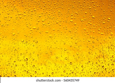 Drops of water on a glass of beer. Background, Texture