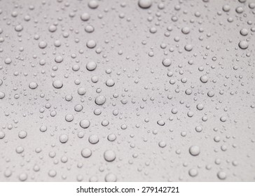 Drops of water on a luxury car