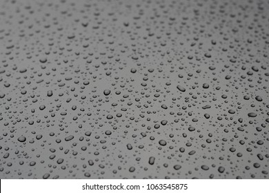 drops of water on a metal surface closeup