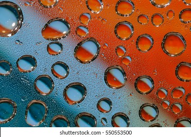 Drops of water on plastic, colorful backgrounds. (The image depth)