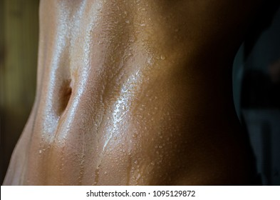 Drops of water on the skin of the abdomen