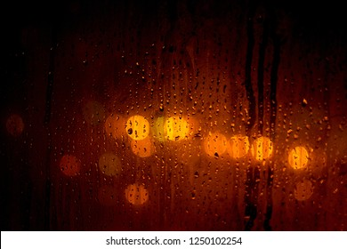 DropsWater drops on the window and bokeh background