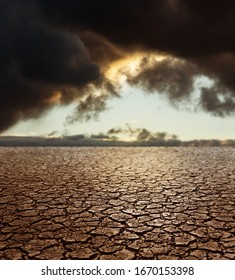 Drought Earth - Cracked Land with Stormy Sky on Background