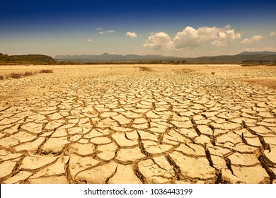 Drought land. Ground into the dry season. Drought, the ground cracks, no hot water, lack of moisture. Global worming effect. Crack soil on dry season. Abstract natural background with cracked earth.