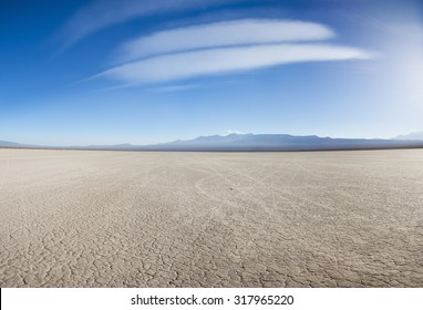 Drought land on the Pampa of El Leoncito with the Andean mountains against a clear blue sky. San Juan Province, Argentina
