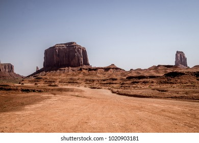 Drought in the southwest of the USA. Road in the rocky desert of the Monument Valley