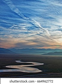 Drought stricken Lake Isabella at sunrise in the Sierra Nevada mountains in Central California USA