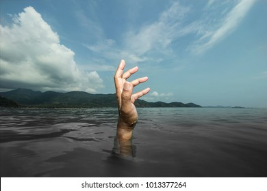 The drowning hand is reaching up to find the light to escape from the suffering.