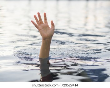 Drowning victims, Hand of drowning woman needing help.   Failure and rescue concept.