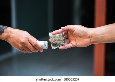 Drug addict buying narcotics and paying