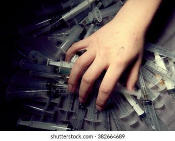Drug addict. Photo a of human hand with syringe.