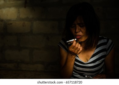 Drug addict young woman with syringe in action, Drug abuse concept.