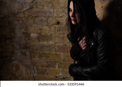 Drug addiction concept. Drug addict posing near brick wall and having breaking in body. Drug abuse concept.