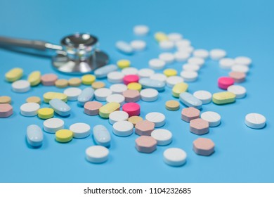 drug with colorful pills and blue background,drug,Prescription