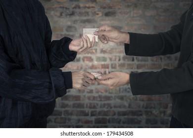 Drug dealer taking money for heroine