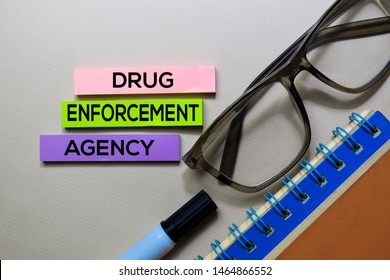 Drug Enforcement Agency - DEA text on sticky notes isolated on office desk