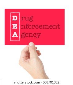 Drug Enforcement Agency explained on a card held by a hand