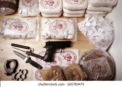 Drug packages, raw opium, drug dozens and weapons seized by police