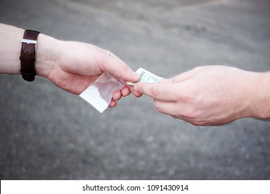 Drug selling concept. Close up hands, trading meth.