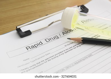 Drug test blank form with pen and urine