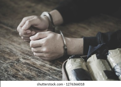 Drug traffickers were arrested along with their heroin. Police arrest drug trafficker with handcuffs. Law and police concept,World Anti-Drug Day, 26 June, International Day Against Drug Abuse.