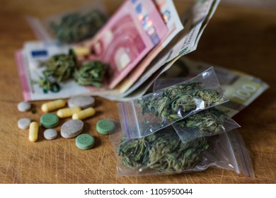 drug trafficking concept of the crime. Tablets, pills and cannabis lie on cash. money euros and hryvnia illegal.