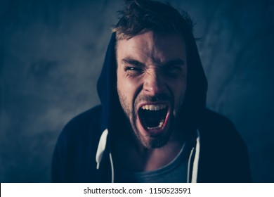 Drug use taker desperate addict person concept. Close up photo portrait of angry annoyed irritated with yellow teeth red eyes guy screaming at camera isolated balck background
