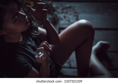 Drugs concept.Drug addict woman with syringe using drugs.Dark theme, young girl very stressed, He would drug addiction.